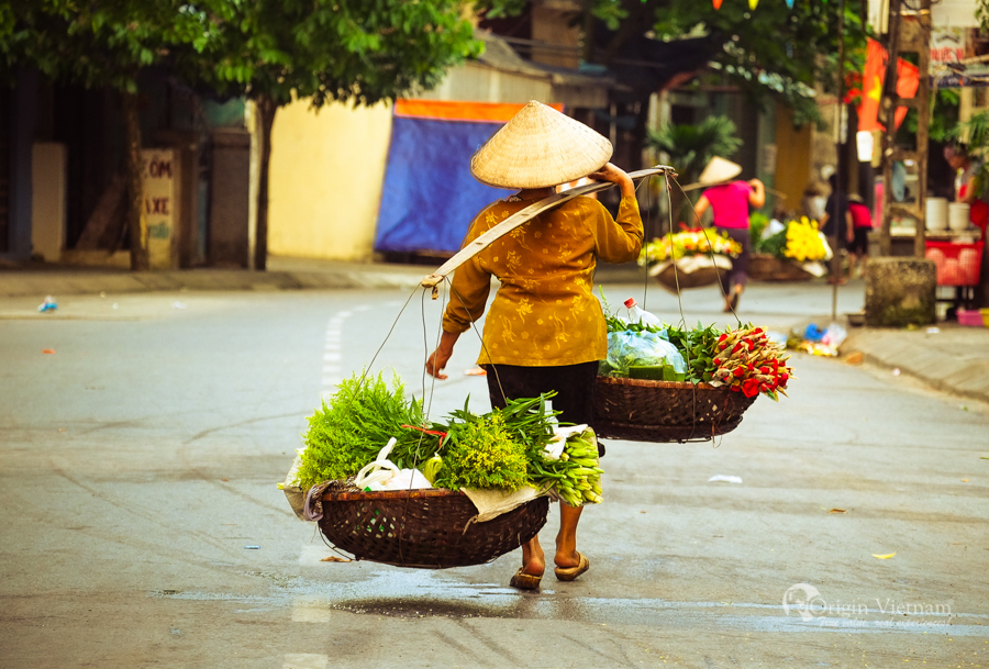 old woman selling flower in Hanoi