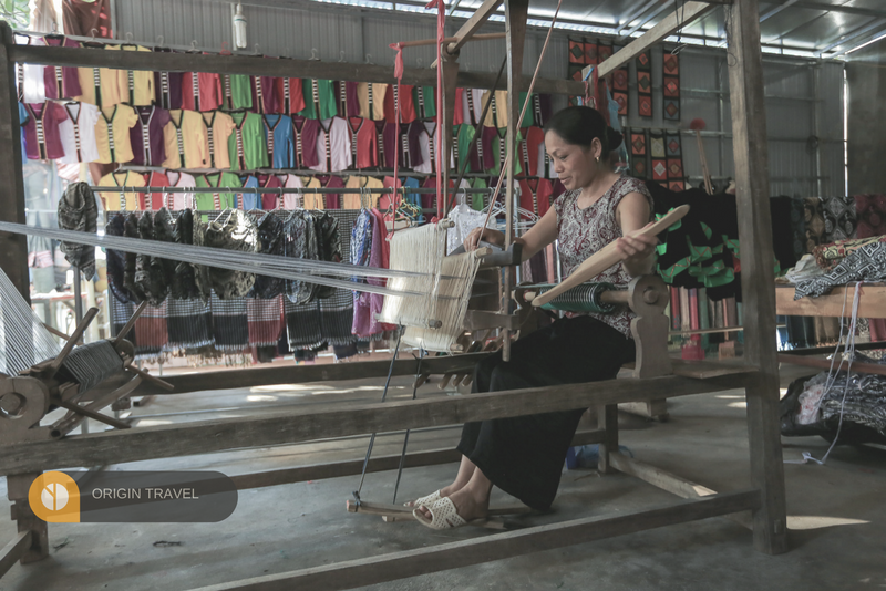 Thai woman is weaving to make Thai Traditional clothes