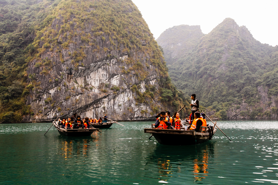 Visit cave in Halong Bay by bamboo boat