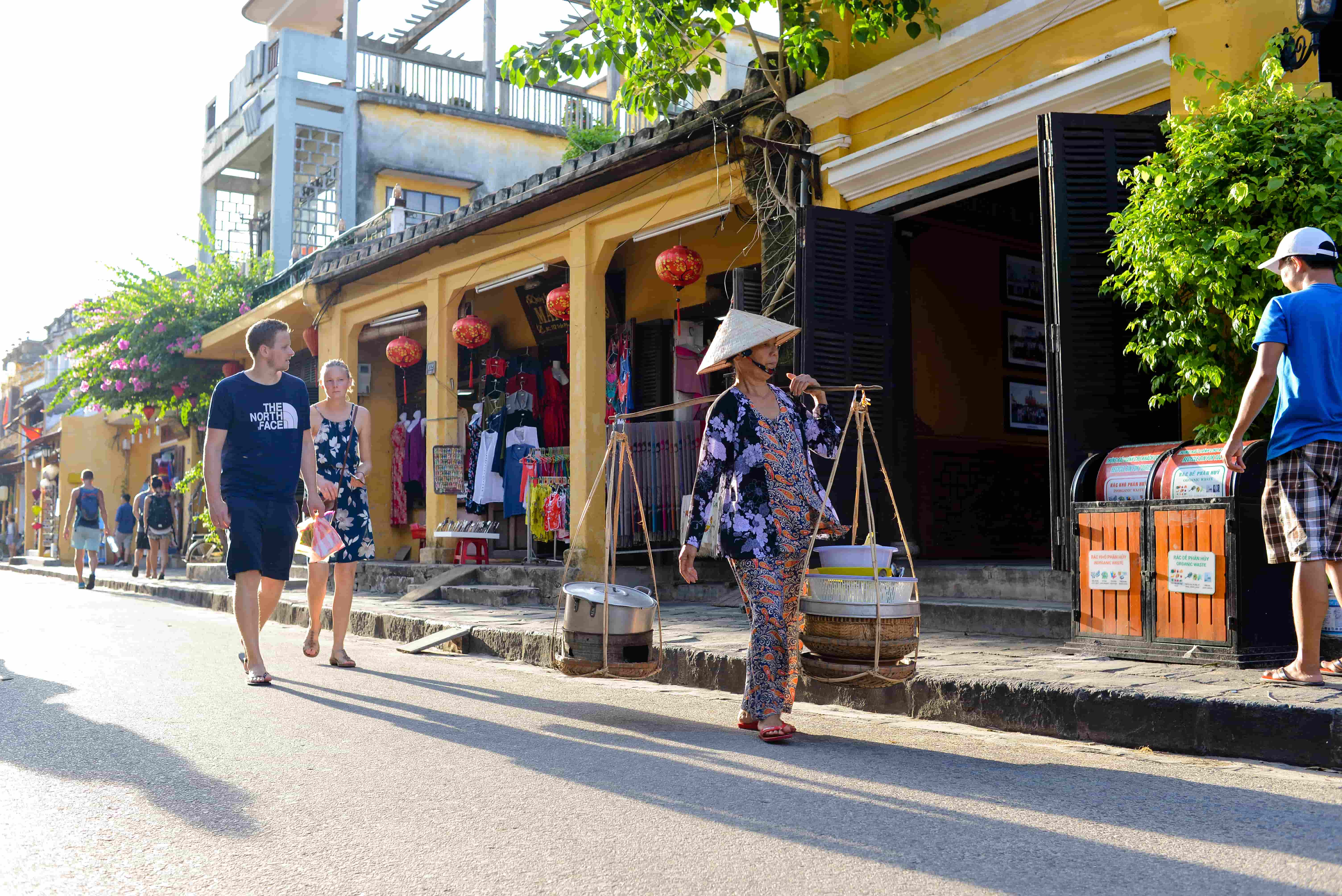 Walk along streets and taste street foods - Hoian tours