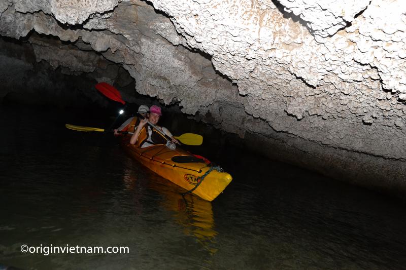Kayak through dark cave in Lan Ha Bay