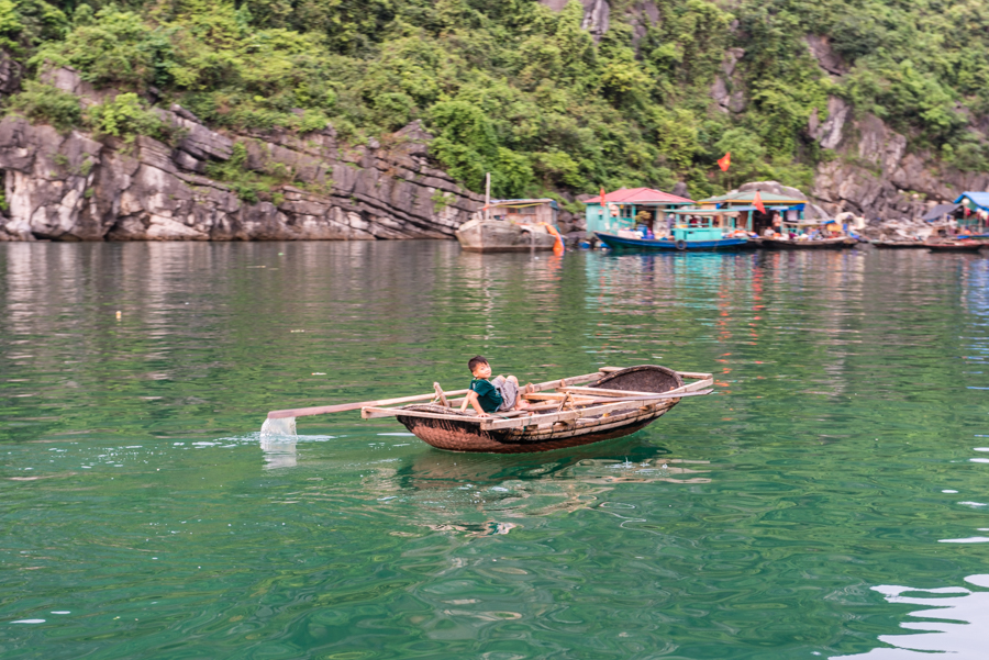 image of child rowing in Cua Van fishing village