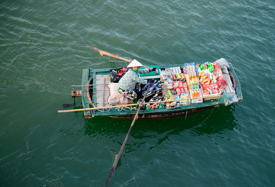 Image of woman selling near Dinh Huong islet